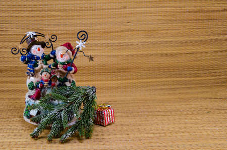 Snowman family on a wooden background, fully dressed and festive photo