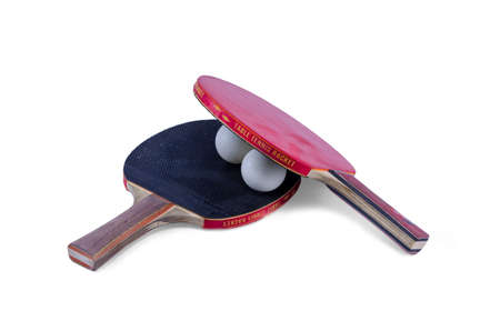 Two ping-pong rackets and a ball isolated photo