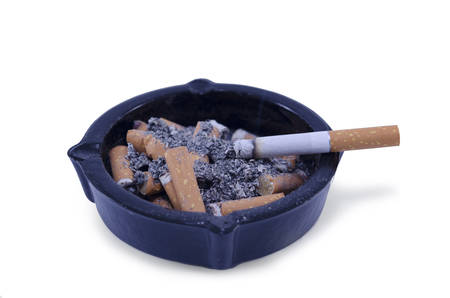 Ashtray filled with cigarette butts and ash, isolated photo