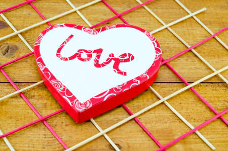fancy sweet box: Heart shaped box decorated on a wooden table Stock Photo