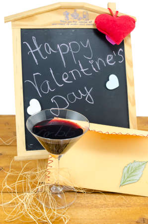 happy valentines: Blackboard with the words Happy Valentines written on it, decorated with hearts, a candle and a wine glass
