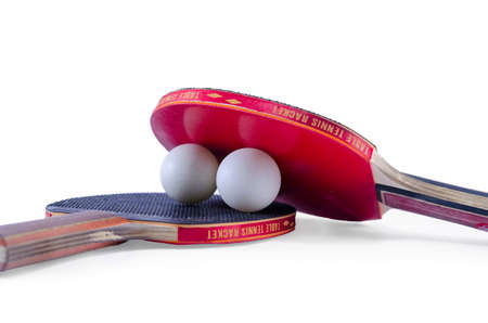 Two table tennis rackets and a ball isolated photo