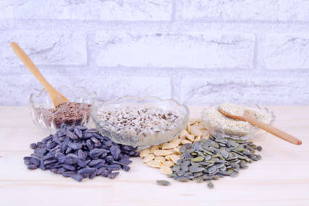 seeds of various: Various pumpkin seeds, sunflower seeds and many other on a table Stock Photo