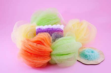 Colorful bath sponge with peeling soap and sea salt