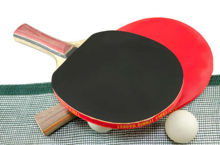 Two table tennis rackets and an old net isolated on white photo