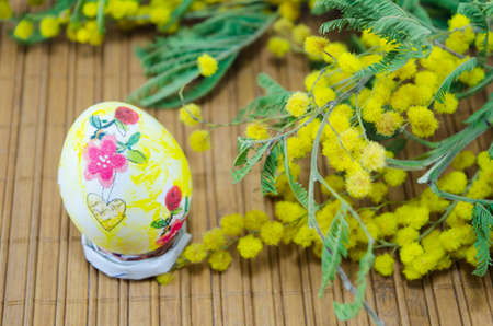 decoupage: Hand painted decoupage Easter egg and mimosa flowers Stock Photo