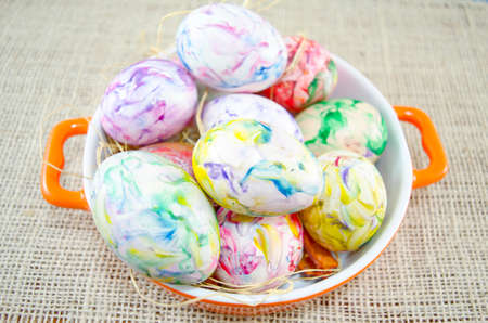 hand colored: Bunch of hand colored Easter eggs close up in a metal pot