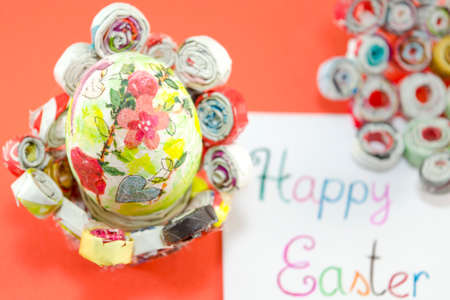 decoupage: Handmade decoupage Easter egg on a handmade paper plate with a Happy Easter card Stock Photo