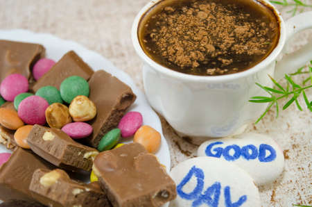bonbons: Chocolate coffee with bonbons and a good day message written on pebbles