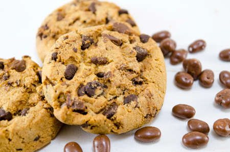 chocolate balls: Chocolate chip cookies on white background with chocolate balls Stock Photo