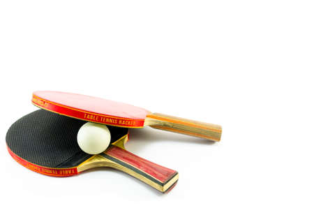 tabletennis: Two ping-pong rackets and a ball isolated on white