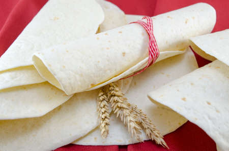 tortillas: Empty tortillas tied with a ribbon on a table Stock Photo