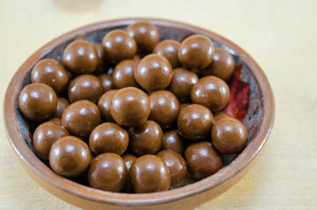 chocolate balls: Shiny chocolate balls in a plate