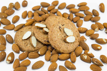 table covered with raw almonds and integral cookies
