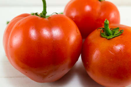 recently: Bunch of recently washed tomatos close up Stock Photo