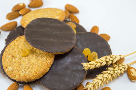 Integral chocolate cookies with almonds and wheat on white