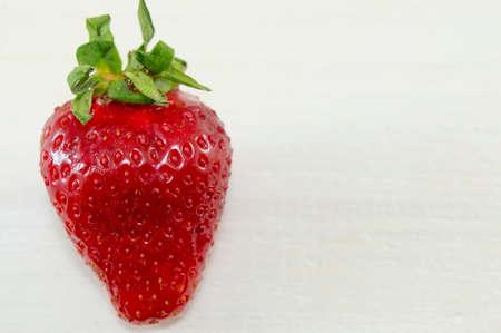 luscious: One luscious strawberry on white background Stock Photo