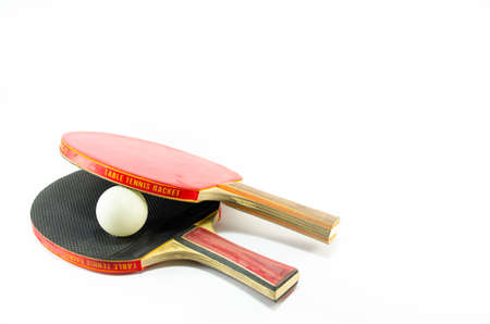 tabletennis: Two table tennis rackets and a ball isolated on white