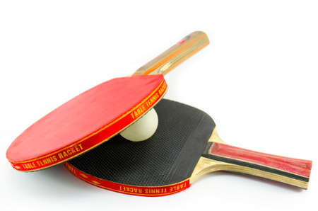 tabletennis: Two ping-pong rackets and a ball between isolated Stock Photo