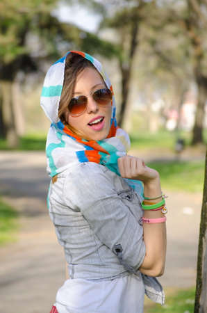 bandana girl: Girl enjoying spring wearing a colorful bandana and sunglasses Stock Photo