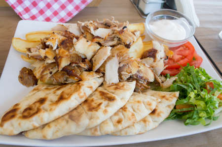 Pork gyros in a plate on a table