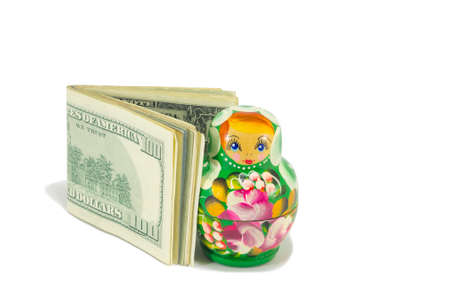 babushka: Russian babushka dolls with american dollar bills isolated Stock Photo