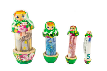 babushka: Traditional Russian babushka  matreshka dolls with euro bills isolated
