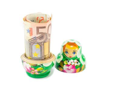 Russian babushka  doll with 50 euro bill isolated