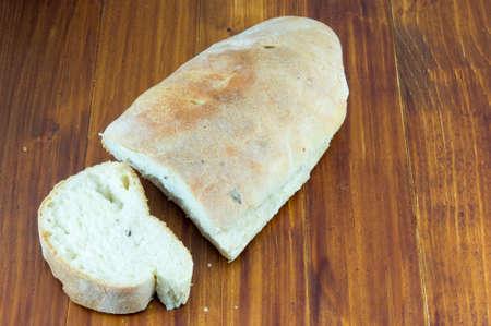homemade bread: Cut homemade bread on a table