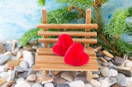 two hearts: Scene set with two hearts on a miniature wooden bench
