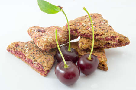 integral: Integral cherry cookies with fresh cherry fruit  on white