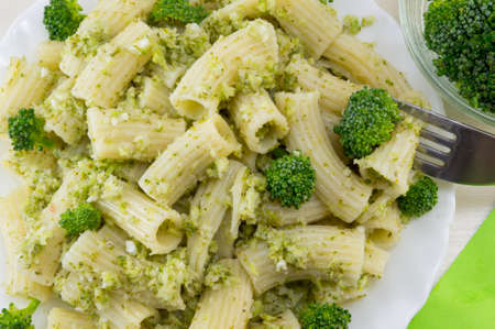 Cooked pasta with broccoli served with cooked broccoli close up Banco de Imagens
