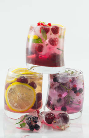 non alcoholic: Three natural and non alcoholic fruit cocktails on top of each other with fruit in ice. Cold summer refreshment