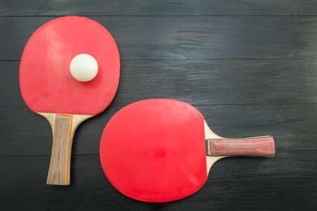 tabletennis: Pair of red table tennis rackets on dark background