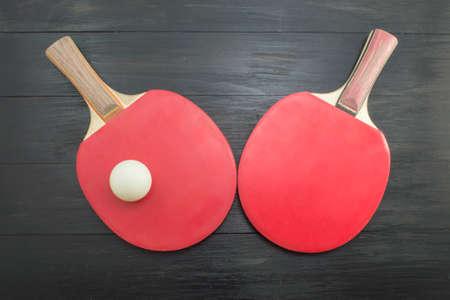 tabletennis: Pair of red table tennis paddles on dark background