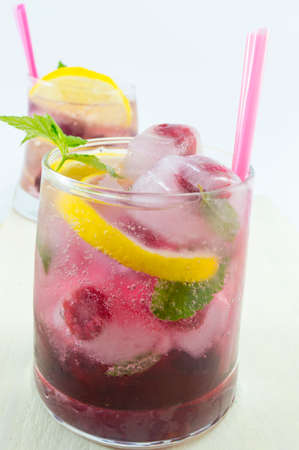 icecube: Natural homemade red forest fruit iced-T juice with ice, lemon and sliced fruits