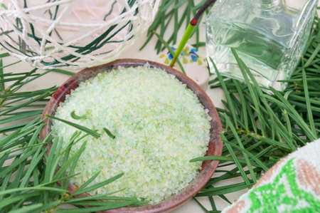 parfume: Gren bath salt in a bowl  with rosemary on next to parfume bottle