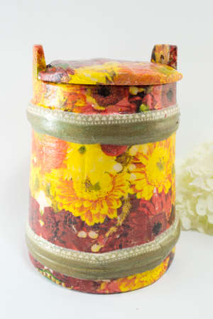 decoupage: Decoupage decorated flower pattern jar with flowers on white background Stock Photo