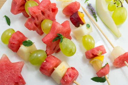 healthy snack: Fruit kebab. Fruit salad arranged like kebab. Healthy snack Stock Photo