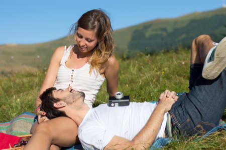 out of date: Loving couple out in the field expressing feelings. Outdoors date