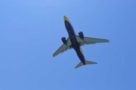 Airplane take of close. Plane rising