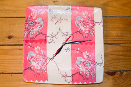 decoupage: Decoupage decorated clock on wooden backgound