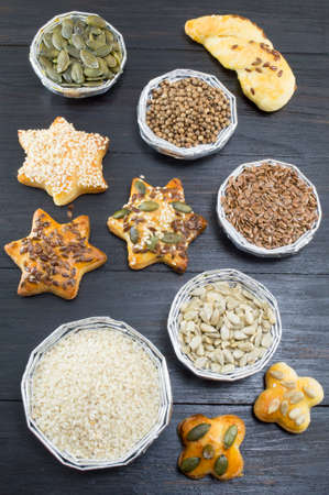 seeds of various: Various seeds in shiny bowls with homemade pastry covered with seeds
