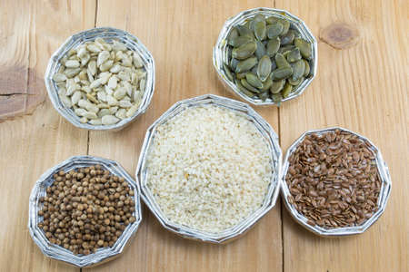 seeds of various: Various seeds in round shiny bowls