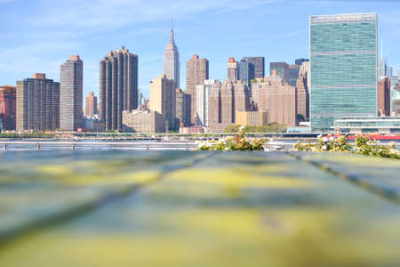 fense: View at the Manhattan panorama over a wooden fense on a sunny day Stock Photo