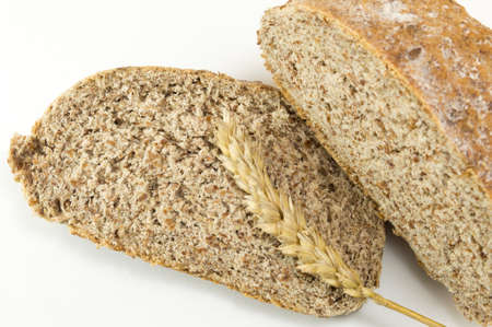 Integra bread slices and natural wheat  on white background