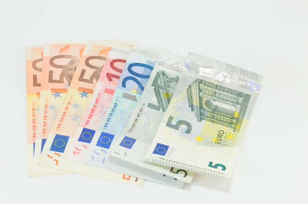 Various Euro bills placed on a white background