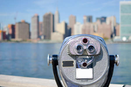 city landscape: Shiny binoculars with stunning Manhattan view Stock Photo