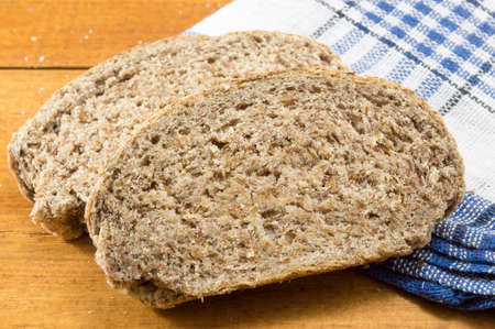 home baked: Home baked integral brown bread slices on the table Stock Photo