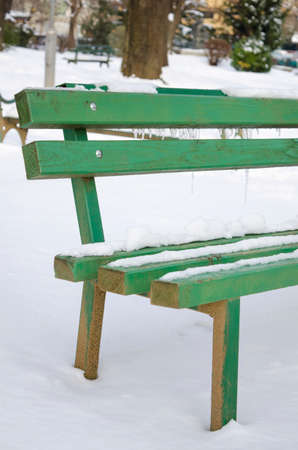 ice covered: Snow and ice covered bench in a park Stock Photo